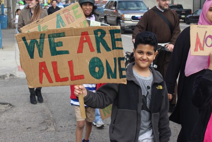 Faith-based coalition marches to protect rights of refugees