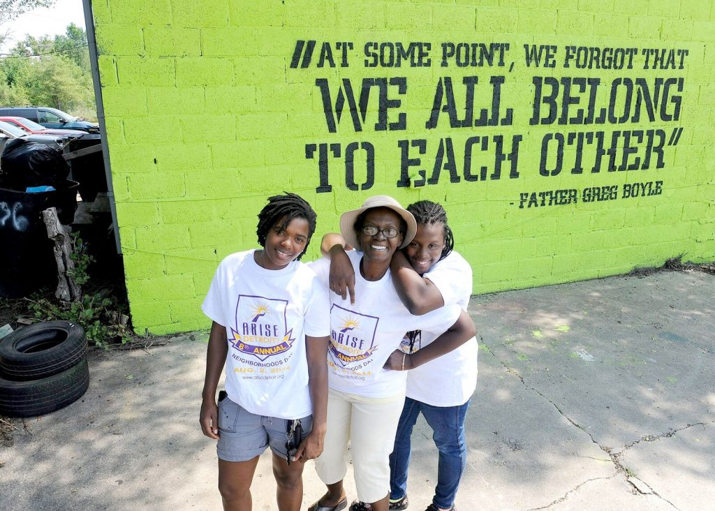 Rondaeya Redding and her mother work on a mural project with Rebecca (Bucky) Willis