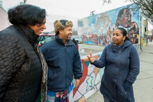 Latrice McClendon (right), who moved back to North Rosedale Park from Canton to be part of Detroit renewal, chats with Reggie Davis (center) and Stephanie Young (left)