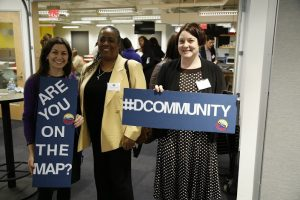 Phyllis Edwards (center), Bridging Communities Inc. Executive Director, CDAD Member and user of d[COM]munity joins other guests at d[COM]'s launch event.