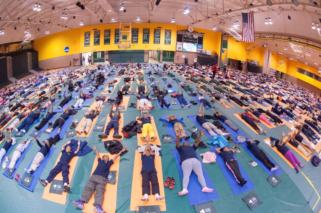 Elementary school kids doing yoga at the ACES event