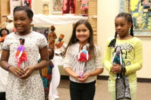 Kids with their dolls at the Color Me Beautiful Workshop.