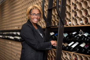 House of Pure Vin co-owner Regina Gaines at her wine shop in Detroit.