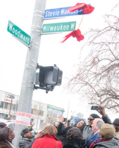 Motown Museum Chair and Executive Director Robin Terry and Mayor Mike Duggan flank Stevie Wonder, right, below Stevie Wonder Avenue sign. Detroit renamed Milwaukee Avenue in Stevie Wonder's honor in ceremony near corner of Woodward Avenue.