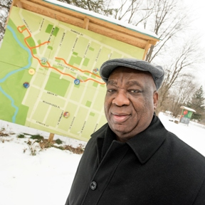 McDonald's owner-operator and Detroit investor poses in the Brightmoor neighborhood.