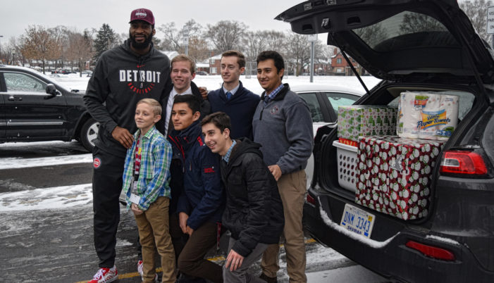 U of D Jesuit students team up with Pistons' Andre Drummond to adopt 42 Detroit families for Christmas