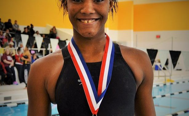 World-class competitive deaf swimmer Detroiter AnQuniece Wheeler returns to city rec center to train, inspire others