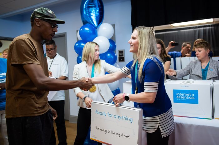 Comcast surprises 150 low-income veterans, 100 youth with free laptops